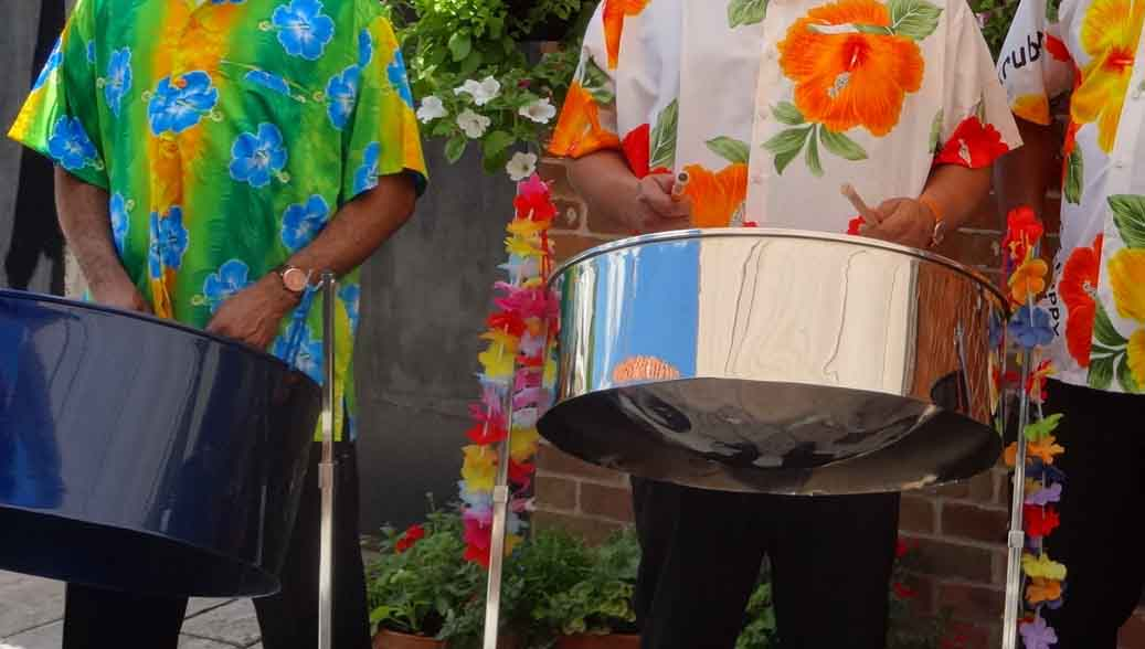 Steel bands for hire in Surrey, steel band for garden party Leatherhead, lively band for garden party Cobham, Steel drum band for garden party Oxshott, bands for garden party in Purley,